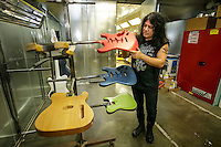 Michael Ciravolo with some freshly painted guitar bodies at Schechter Guitar Research in Sun Valley, Ca.   Feb. 21, 2017  Photo by David Sprague