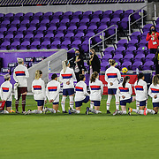 ORLANDO, FL - JANUARY 22: Players from the United States Womens National soccer team kneel during the national anthem before a game against Colombia at Exploria Stadium on January 22, 2021 in Orlando, Florida. (Photo by Alex Menendez/Getty Images) *** Local Caption ***