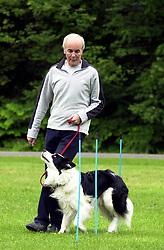 Eddie Sander with his Dogs Jackson and Inka<br /> <br /> 18 June 2004<br /> <br /> Copyright Paul David Drabble<br /> <br /> [#Beginning of Shooting Data Section]<br /> Nikon D1 <br /> <br /> Focal Length: 170mm<br /> <br /> Optimize Image: <br /> <br /> Color Mode: <br /> <br /> Noise Reduction: <br /> <br /> 2004/06/18 09:14:04.0<br /> <br /> Exposure Mode: Programmed Auto<br /> <br /> White Balance: Auto<br /> <br /> Tone Comp: Normal<br /> <br /> JPEG (8-bit) Fine<br /> <br /> Metering Mode: Multi-Pattern<br /> <br /> AF Mode: AF-S<br /> <br /> Hue Adjustment: <br /> <br /> Image Size:  2000 x 1312<br /> <br /> 1/125 sec - F/6<br /> <br /> Flash Sync Mode: Not Attached<br /> <br /> Saturation: <br /> <br /> Color<br /> <br /> Exposure Comp.: 0 EV<br /> <br /> Sharpening: Normal<br /> <br /> Lens: 80-200mm F/2.8<br /> <br /> Sensitivity: ISO 200<br /> <br /> Image Comment: <br /> <br /> [#End of Shooting Data Section]