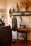 An old style room with jacket and sewing machine