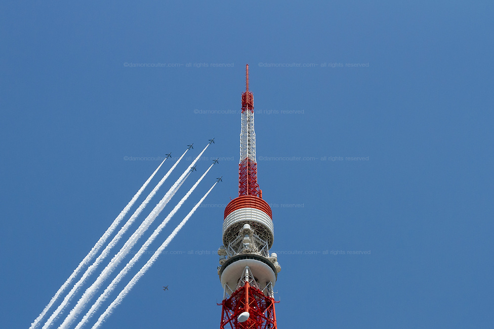"The JASDF Blue Impulse aerobatics team do a fly past over Tokyo Tower in Tokyo. Friday May 29th 2020 . From 12:40 to 1pm the Kawasaki T4 aircraft of the Japanenese Air Self Defence Force aerobatics display team circled the major sites of the city along with hospitals caring for Corona patients, trailing white smoke, as a ""thank you"" to healthcare workers for their efforts during the COVID-19 State of Emergency that was ended on Monday may 25th The JASDF Blue Impulse aerobatics team do a fly past over Tokyo Tower in Tokyo. Friday May 29th 2020 . From 12:40 to 1pm the Kawasaki T4 aircraft of the Japanese Air Self Defence Force aerobatics display team circled the major sites of the city along with hospitals caring for Corona patients, trailing white smoke, as a ""thank you"" to healthcare workers for their efforts during the  COVID-19 State of Emergency that was ended on Monday, May 25th"