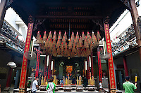 Large incense urns with spiral incense hanging overhead at Tian Hou tempe in Ho Chi Minh City.