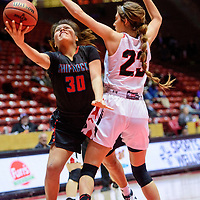 Shiprock Chieftain Tia Woods (30) attempts a layup around Portales Ram Lindsay Blakey (23) in a District 4A semifinal at The Pit in Albuquerque Thursday.