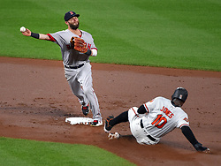 September 20, 2017 - Baltimore, MD, USA - Boston Red Sox second baseman Dustin Pedroia turns a double play over the Baltimore Orioles' Adam Jones (10) to end the second inning at Oriole Park at Camden Yards in Baltimore on Wednesday, Sept. 20, 2017. The Red Sox won, 9-0. (Credit Image: © Lloyd Fox/TNS via ZUMA Wire)
