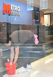 © Licensed to London News Pictures. 16/10/2018<br /> Bromley, UK.<br /> Cleaning up the bank.<br /> A 50 year old man has been arrested by police after trying to set him self on fire in the Metro Bank in Bromley High, Bromley. The bank has been closed and police are on scene with bank staff.<br /> Photo credit: Grant Falvey/LNP