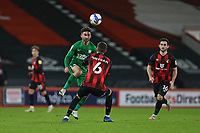 Football - 2020 / 2021 Sky Bet Championship - AFC Bournemouth vs. Preston North End - The Vitality Stadium<br /> <br /> Sean Maguire of Preston lifts the ball over Bournemouth's Chris Mepham during the Championship match at the Vitality Stadium (Dean Court) Bournemouth <br /> <br /> COLORSPORT/SHAUN BOGGUST