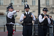 On US President Donald Trumps first day of a controversial three-day state visit to the UK by the 45th American President, British Met Police officers secure the Mall outside Buckingham Palace, on 3rd June 2019, in London England.