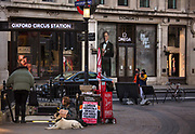 Homeless man begging for money outsise Oxford Circus Station during the Coronavirus pandemic on 26th March 2020 in London, United Kingdom. UK hotels will be converted into shelters for homeless people during COVID-19 outbreak.