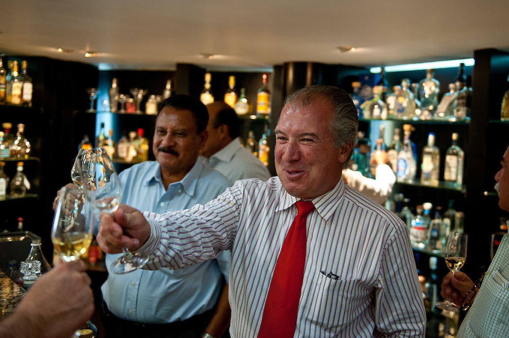 Eduardo Orendain Giovannini, President of the National Chamber of Commerce of the Tequila Industry, has a drink at the Chamber's private tequila cantina.