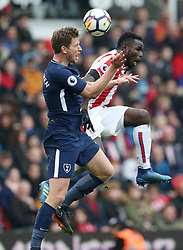 Stoke City's Mame Diouf and Tottenham Hotspur's Jan Vertonghen battle for the ball in the air