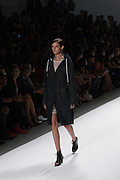 A long hooded coat by Richard Chai at the Spring 2013 Mercedes Benz Fashion Week show in New York.