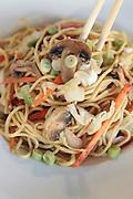 Stir fried vegetarian noodles with mushrooms