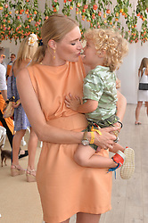 JODIE KIDD and her son INDIO VIANINI KIDD at the Veuve Clicquot Gold Cup Final at Cowdray Park Polo Club, Midhurst, West Sussex on 20th July 2014.