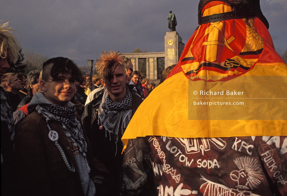 A year after the fall of the Berlin Wall and the end of the Communist Eastern Bloc era, German youths gather at a war memorial, on 4th November 1990, in Berlin, Germany.