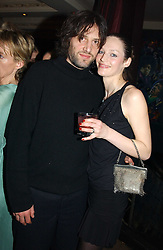 Model VIVIEN SOLARI and her husband NICK MILLS at a party for the ICM Model agency held at Embassy, Old Burlington Street, London W1 on 14th February 2005.<br />
