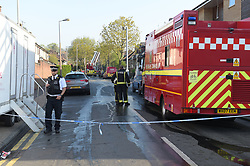 © Licensed to London News Pictures, 20/04/2018, Firefighters  at the scene of a block of nine assisted living flats in Connington Crescent, Chingford in East London, where fire had destroyed the roof and most of the interior of the flats. The alarm was raised around 2.15 am on Friday morning where  a female resident from the flats was found dead by emergency services; Photo credit: Steve Poston/LNP