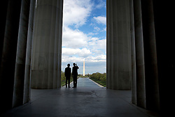 President Barack Obama and Prime Minister Shinzo Abe of Japan look toward the Washington Monument during a visit to the Lincoln Memorial in Washington, D.C., April 27, 2015. (Official White House Photo by Pete Souza)<br /> <br /> This official White House photograph is being made available only for publication by news organizations and/or for personal use printing by the subject(s) of the photograph. The photograph may not be manipulated in any way and may not be used in commercial or political materials, advertisements, emails, products, promotions that in any way suggests approval or endorsement of the President, the First Family, or the White House.