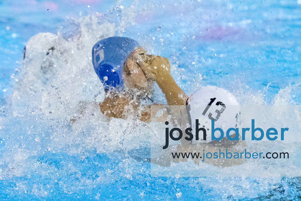 Corona del Mar's Matther Ueberroth, Foothill's Whittaker Worland during a CIF-SS Division 2 Semifinal at William Woollett Jr. Aquatic Center on Wednesday, November 7, 2018 in Irvine, California. (Photo/Josh Barber)