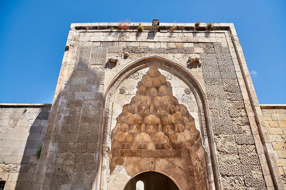 The marble crown gate of the Sifaiye Medrese has a very rich decorative appearance, 1217. Its islamic Muqarnas corbelled vault is made up of a large number of miniature squinches, producing a sort of cellular structure. Sivas, Turkey .<br /> <br /> If you prefer to buy from our ALAMY PHOTO LIBRARY  Collection visit : https://www.alamy.com/portfolio/paul-williams-funkystock/sivas-turkey.html<br /> <br /> Visit our TURKEY PHOTO COLLECTIONS for more photos to download or buy as wall art prints https://funkystock.photoshelter.com/gallery-collection/3f-Pictures-of-Turkey-Turkey-Photos-Images-Fotos/C0000U.hJWkZxAbg