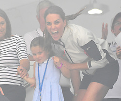 The Duchess of Cambridge and Princess Charlotte at The King's Cup Regatta, Cowes, Isle of Wight. Photo credit should read: Doug Peters/EMPICS