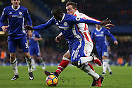 Ngolo Kante of Chelseais fouled by Xherdan Shaqiri of Stoke City. Premier league match, Chelsea v Stoke city at Stamford Bridge in London on Saturday 31st December 2016.<br /> pic by John Patrick Fletcher, Andrew Orchard sports photography.