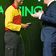NLD/Amsterdam//20140331 - Uitreiking Edison Pop 2014, een DHL koerier neemt de award voor Anouk in ontvangst