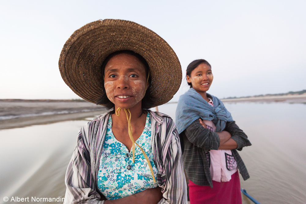 Woman going home by boat from long day working the farm fields, Ayeyarwady River, Bagan