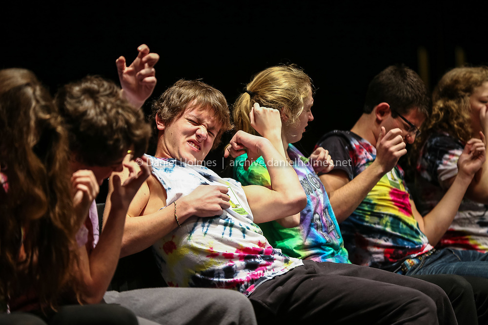 (3/10/14, WESTBOROUGH, MA) Westborough High seniors are hypnotized to play air guitar by hypnotist Dan Candell during a program at Westborough High School on Monday. Daily News and Wicked Local Photo/Dan Holmes