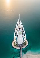 Aerial view of the luxurious Burj Al Arab Hotel on a sunny day in Dubai bay, U.A.E.