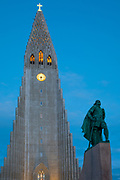 Hallgrímskirkja is a Lutheran (Church of Iceland) parish church in Reykjavík, Iceland. At 74.5 metres (244 ft) high, it is the largest church in Iceland and among the tallest structures in Iceland. The church is named after the Icelandic poet and clergyman Hallgrímur Pétursson (1614–1674), author of the Passion Hymns. Situated in the centre of Reykjavík, it is one of the city's best-known landmarks and is visible throughout the city. State Architect Guðjón Samúelsson's design of the church was commissioned in 1937. He is said to have designed it to resemble the trap rocks, mountains and glaciers of Iceland's landscape. The design is similar in style to the expressionist architecture of Grundtvig's Church of Copenhagen, Denmark, completed in 1940.