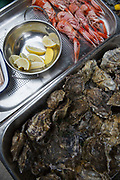 Fresh oysters and king prawns on display Maltby Street Market on 17th October 2015 in London, United Kingdom. Opening in 2010, Maltby Street is an artisan food market under the railways arches in Bermondsey, London.