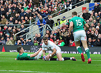 Football - 2020 Guinness Six Nations Championship - England vs. Ireland<br /> <br /> George Ford of England grabs the loose ball to score his early try, at Twickenham.<br /> <br /> COLORSPORT/ANDREW COWIE