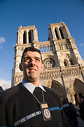 The modern day Quasimodo of Notre Dame Cathedral. Paris, France.  Stephane Urbain is the Chief Sacristain. Apart from his other duties, he is in charge of all aspects of the bells. There are at least four masses each day everyday of the year. The bells sound on the hour and half hour, and there are special melodies played at certain times, for festivals, celebrations and events. Stephane Urbain writes and calibrates the bells co-ordinated with a computer. the days of manual bell ringers and 'clochards' are in the past.///Stephaine Urbain, Head Sacristain of Notre Dame Cathedral, in front of the Cathedral