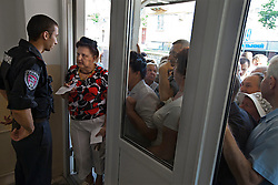 A crowd tries to enter the local courthouse in Rivne, Ukraine, June 16, 2011. Attorneys and paralegals advise clients to file their papers during a Òspecial consultationÓ for potential clients who are children of the Second World War. This vulnerable group is made up of seniors, most of whom are not receiving proper compensation as promised by the government. The legal team advises them on how to properly fill out forms and submit them to the courthouse, while encouraging them not to give up on their rights. More than half of the worldÕs population, four billion people, live outside the rule of law, with no effective title to property, access to courts or redress for official abuse. The Open Society Justice Initiative is involved in building capacity and developing pilot programs through the use of community-based advocates and paralegals in Sierra Leone, Ukraine and Indonesia. The pilot programs, which combine education with grassroots tools to provide concrete solutions to instances of injustice, help give poor people some measure of control over their lives.