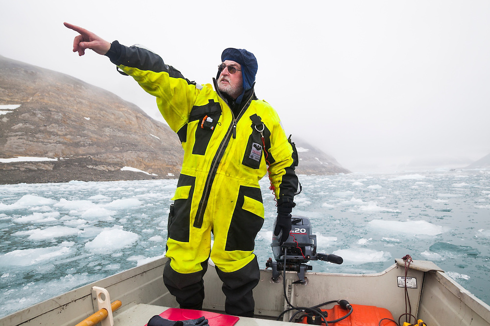 Glaciologist Jacek Jania skillfully navigates a motorboat through the ice-choked forebay of Paierlbreen, an actively calving tidewater glacier, in Hornsund, Svalbard to install time-lapse cameras.