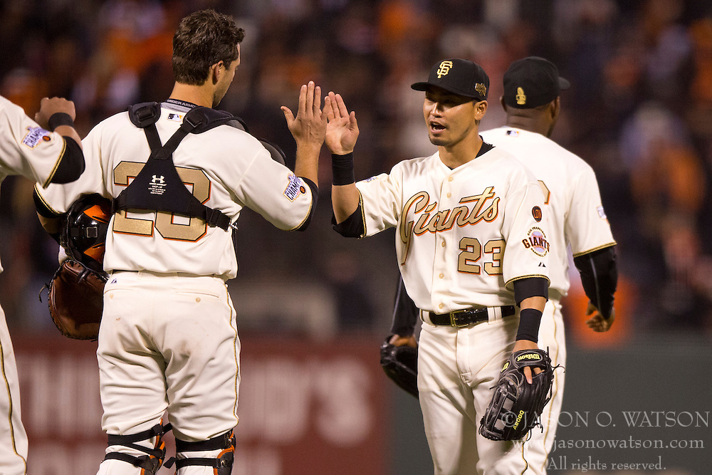SAN FRANCISCO, CA - APRIL 18:  Nori Aoki #23 of the San Francisco Giants celebrates with Buster Posey #28 after the game at AT&T Park on April 18, 2015 in San Francisco, California.  The San Francisco Giants defeated the Arizona Diamondbacks 4-1. (Photo by Jason O. Watson/Getty Images) *** Local Caption *** Nori Aoki; Buster Posey