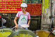 18 SEPTEMBER 2013 - BANGKOK, THAILAND: A worker serves curry at a stand in the Chinatown section of Bangkok. Thailand in general, and Bangkok in particular, has a vibrant tradition of street food and eating on the run. In recent years, Bangkok's street food has become something of an international landmark and is being written about in glossy travel magazines and in the pages of the New York Times.      PHOTO BY JACK KURTZ