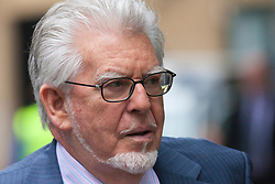 London, May 30th 2014. Veteran entertainer Rolf Harris, 84, arrives at Southwark Crown Court in London where his trial on 12 charges of indecent assault against 4 girls aged 7-19 continues.