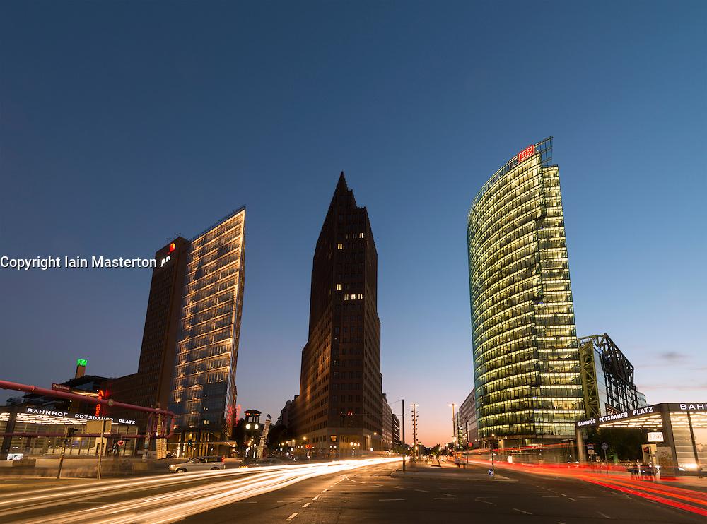 Night view of skyline of high rise buildings in Potsdamer Platz in Mitte Berlin Germany
