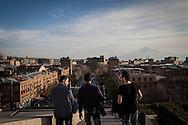 Leon, left, Rafi, centre, and Sako, right, all from Aleppo, visit the Kaskat monument in Yerevan, Armenia.