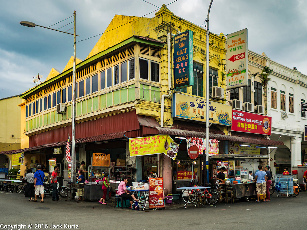 """15 NOVEMBER 2016 - GEORGE TOWN, PENANG, MALAYSIA:  A street food hawker (vendor) spot on Kimberly Street, one of George Town's better known """"food streets."""" George Town is a UNESCO World Heritage city and wrestles with maintaining its traditional lifestyle and mass tourism.           PHOTO BY JACK KURTZ"""