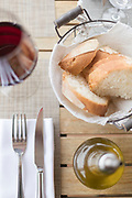 Lunch table setup with cutlery and bread, Cateri, Corsica, France