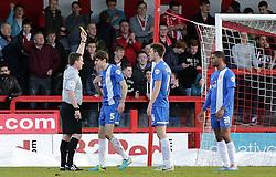 Match referee Lee Collins books Peterborough United's Jack Baldwin for handball - Photo mandatory by-line: Joe Dent/JMP - Tel: Mobile: 07966 386802 01/03/2014 - SPORT - FOOTBALL - Crawley - Broadfield Stadium - Crawley Town v Peterborough United - Sky Bet League One