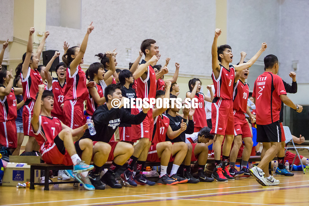 Temasek Polytechnic players cheer during the round robin match of the Polytechnic-Institute of Education Basketball Championship against Republic Polytechnic at College West, Institute of Education, on October 31, 2014, in Singapore.