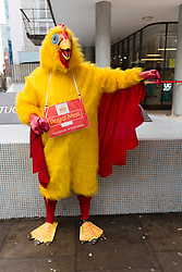 © Licensed to London News Pictures. 19/10/2017. LONDON, UK.  A Royal Mail worker dressed as a chicken prepares to take part in the Communication Workers Union (CWU) protest march from the Trade Union Congress (TUC) Headquarters to Mount Pleasant Delivery Office as part of the long running pensions dispute.  Photo credit: Vickie Flores/LNP