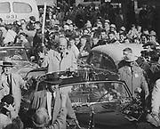 """OPS-08-18Eisenhower visits Portland. He is parading in a """"bubbletop"""" 1950 Lincoln Cosmopolitan limousine. October 18, 1956"""