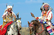 CANADIAN PLAINS INDIANS ON HORSEBACK AT WANUSKEWIN HERITAGE PARK, SASKATOON, CANADA