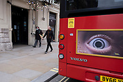 The rear of a Transport for London bus with the close up eye of a speed awareness campaign as the national coronavirus lockdown three continues on 5th March 2021 in London, United Kingdom. With the roadmap for coming out of the lockdown has been laid out, this nationwide lockdown continues to advise all citizens to follow the message to stay at home, protect the NHS and save lives, and the streets of the capital are quiet and empty of normal numbers of people.