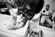A mother taking care of her baby. <br /> In MAC, in Lisbon, Portugal, every year 6000 babies are born, about 6% of all country's births. About 150 of newborns in MAC weight less than 1500 grams. <br /> Meanwhile, the fate of the maternity-hospital is suspended as the portuguese economic crisis is pushing the Government to close the oldest working unit in Portugal.