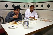 Customers eating at Karims Restaurant, Old Delhi